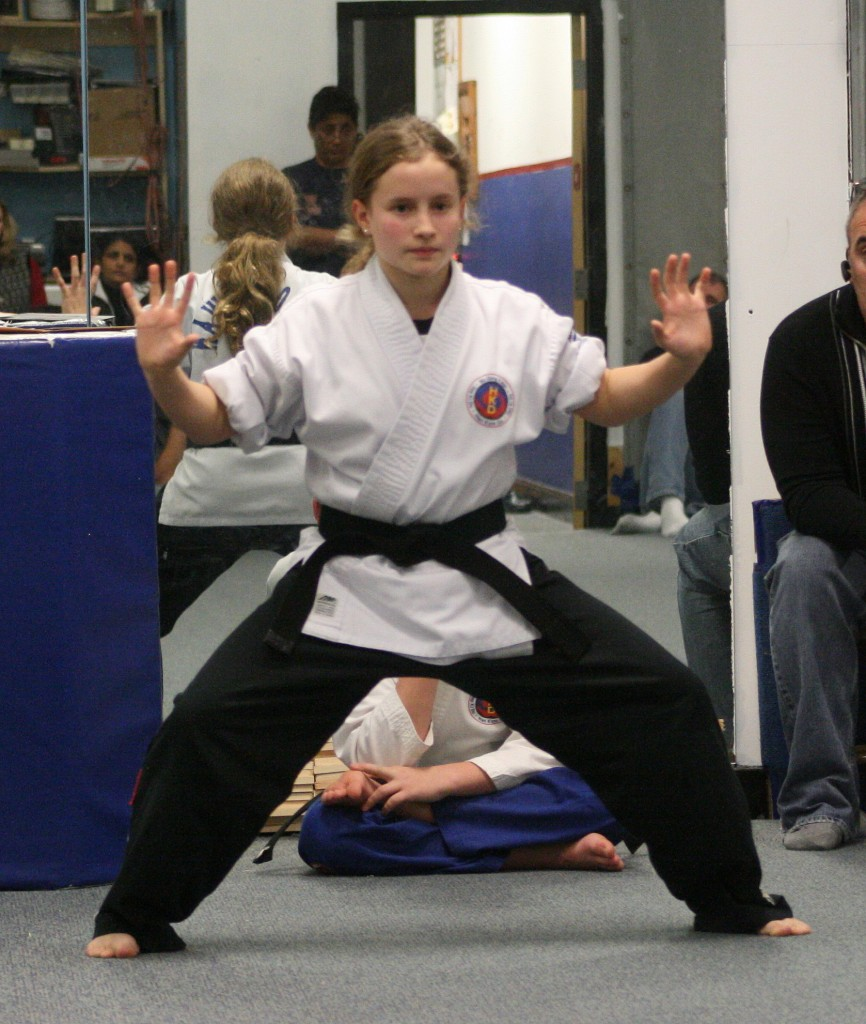 Girl performing Hapkido power breathing exercises